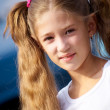 Portrait of little girl with long hair,smiling at the camera — Stock Photo #19261069