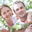 Portrait of Mature couple in the spring garden - Stok fotoğraf