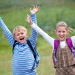 Portrait of boy with girl joyful laugh and throw their hands up — Stock Photo