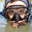 Portrait of diver in diving suit and mask looking out of the water. Close-up — Stock Photo