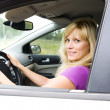 Blonde woman  in car — Stock Photo