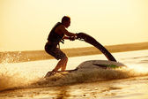 Man jumps on the jetski — Stockfoto