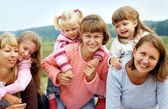 Three mothers with tree daughters — Stock Photo