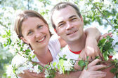 Portrait of Mature couple in the spring garden — Stok fotoğraf