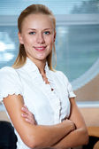 Business woman in white — Stock Photo