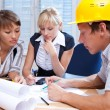 Portrait the team of engineers working on construction project at the table — Stock Photo