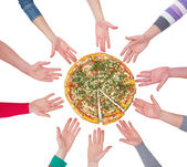 Pizza with human hands — Stock fotografie