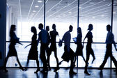 Silhouettes of businesspeople — Stock Photo
