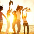 Happy teens dancing at the beach — Stok fotoğraf #22504999