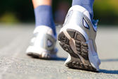 Running shoes on runner — Stock Photo