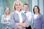 Female leader and team — Stock Photo