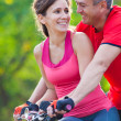 Mature couple on bicycle — 图库照片