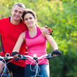 Mature couple on bicycle — Stock Photo #23624409