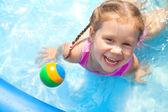 Happy little girl Swimming — Stock Photo