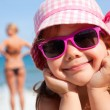 Happy little girl on beach — Stock Photo #23996861