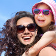 Girl and her mother at the seaside - Stock Photo