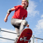 Little girl - skateboarder — Stock Photo