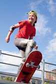 Little girl - skateboarder — Stock Photo