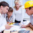 Meeting the team of engineers working on a construction project at the table — Foto Stock