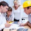 Meeting the team of engineers working on a construction project at the table — Foto de Stock