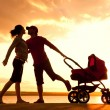 Happy family walking on sunset — Stock Photo
