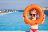 Little girl goes to pool — Stok fotoğraf