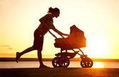 Mother with stroller — Stock Photo