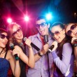 Stock Photo: Karaoke on party