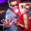 Stock Photo: Young couple having fun dancing at party.