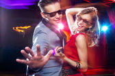 Young couple having fun dancing at party. — Stock Photo