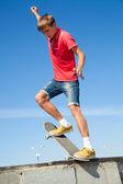 Jump on a skateboard — Stock Photo