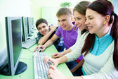 Group of students studying with computer — Stock Photo