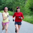 Two running woman — Stock Photo