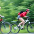 Two  young girls on bicycle — Stock Photo