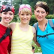Three girlfriends in sports clothes — Stock Photo #29423633