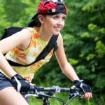 Young girl on bicycle — Stock Photo #29423663