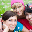 Three girlfriends in sports clothes — Stock Photo #29423815