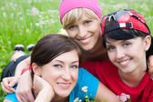 Three girlfriends in sports clothes — Stock Photo