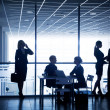 Silhouettes of businesspeople — Stock Photo #30731001