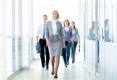 Businesspeople walking — Stock Photo