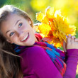 Girl in autumn — Stock Photo