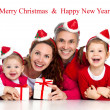 Happy family celebrating Christmas — Stok Fotoğraf #34815635