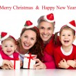 Foto Stock: Happy family celebrating Christmas