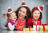 Happy family celebrating Christmas — Stock Photo