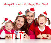 Happy family celebrating Christmas — Stok fotoğraf