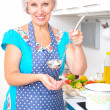 Mature woman on the kitchen — Stock Photo