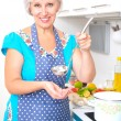 Stock Photo: Mature woman on the kitchen