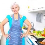 Mature woman on the kitchen — Stock Photo #35684617