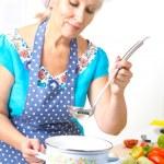 Mature woman on the kitchen — Stock Photo #35684647