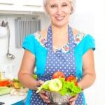 Mature woman on the kitchen — Stock Photo